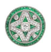 Platinum circular diamond and emerald, fancy design dress ring