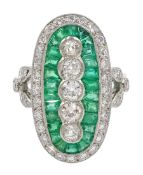 Platinum calibre cut emerald and round brilliant cut diamond oval panel ring