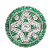 Platinum circular diamond and emerald, fancy design dress ring