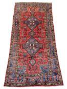 Persian Baluchi red ground rug