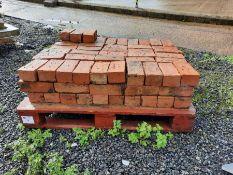 Pallet of red bricks