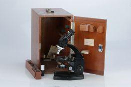 A Binocular Microscope By Cooke Troughton & Simms,