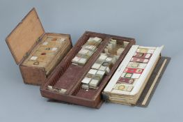 two microscope slide boxes