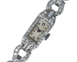 An Art Deco platinum and diamond cocktail watch.