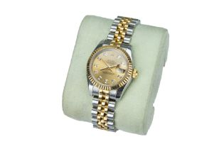 ROLEX. Oyster Perpetual 'DateJust'. A lady's yellow gold and steel wristwatch.