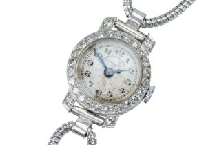 A lady's early 20th century diamond cocktail watch.