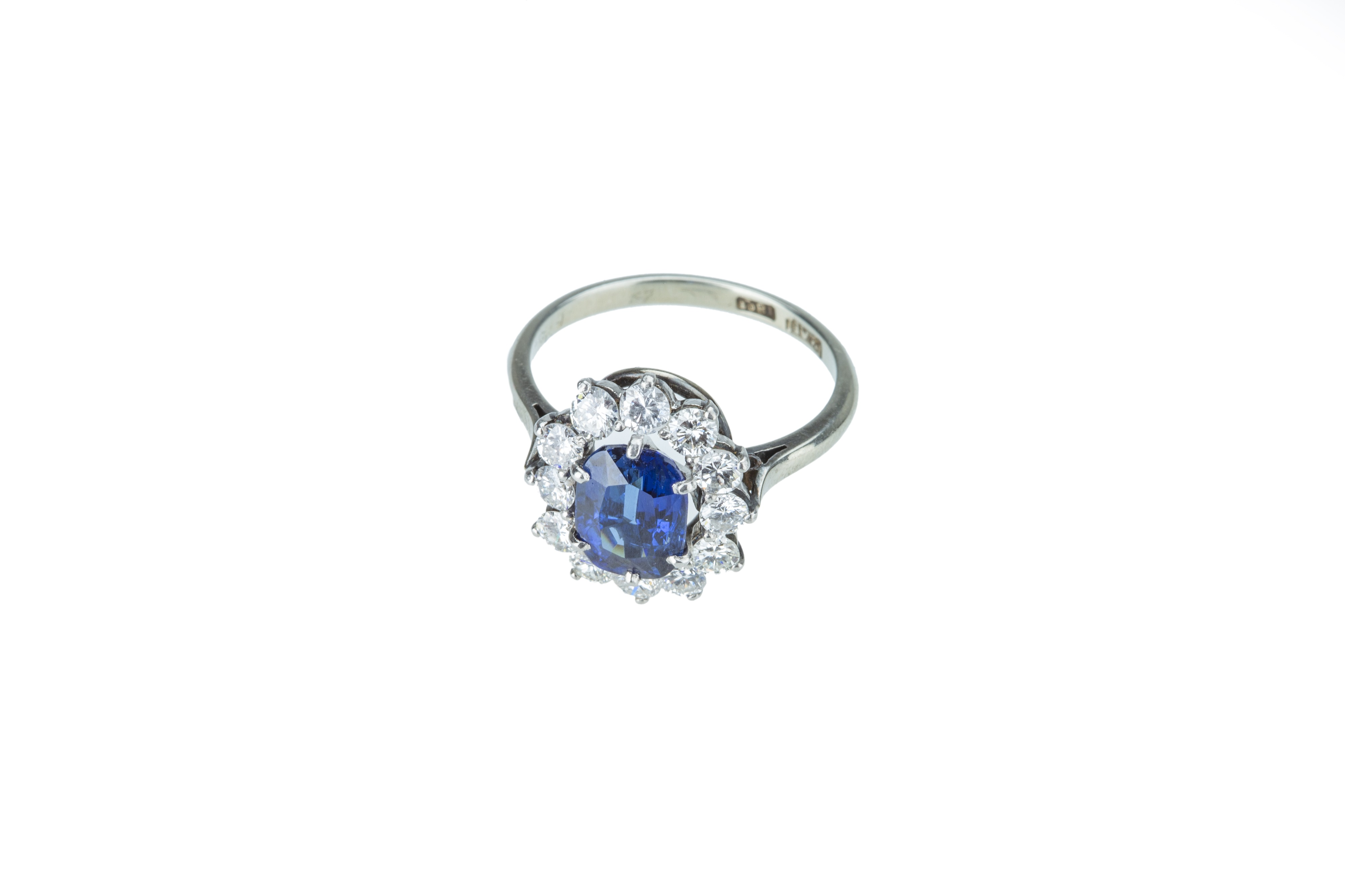 A striking sapphire and diamond cluster ring. - Image 2 of 4