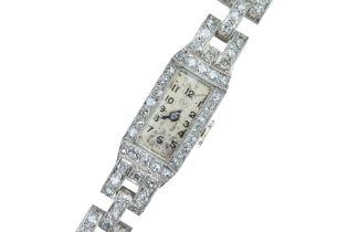 A lady's French Art Deco diamond and platinum cocktail watch.