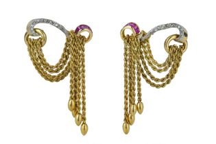 MELLERIO. A pair of 1940s ruby and diamond tassel earrings.