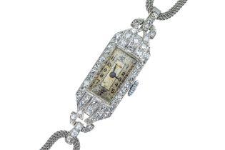Unicorn (by ROLEX). A lady's Art Deco diamond cocktail watch.