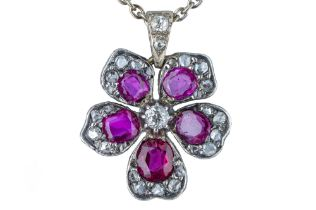 An early 20th century ruby and diamond flower pendant.