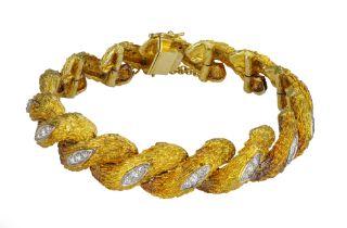 An 18 carat yellow gold and diamond bracelet.