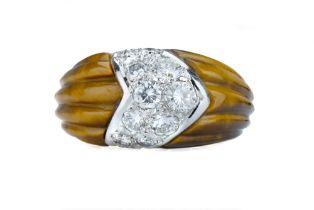 BEN ROSENFELD. A 1950s tigers eye and diamond ring.