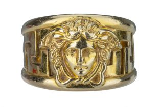 VERSACE. An 18 carat gold band,