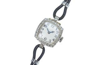 An Edwardian 18 carat gold and diamond cocktail watch.