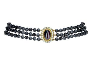 A late Victorian jet and red garnet choker.