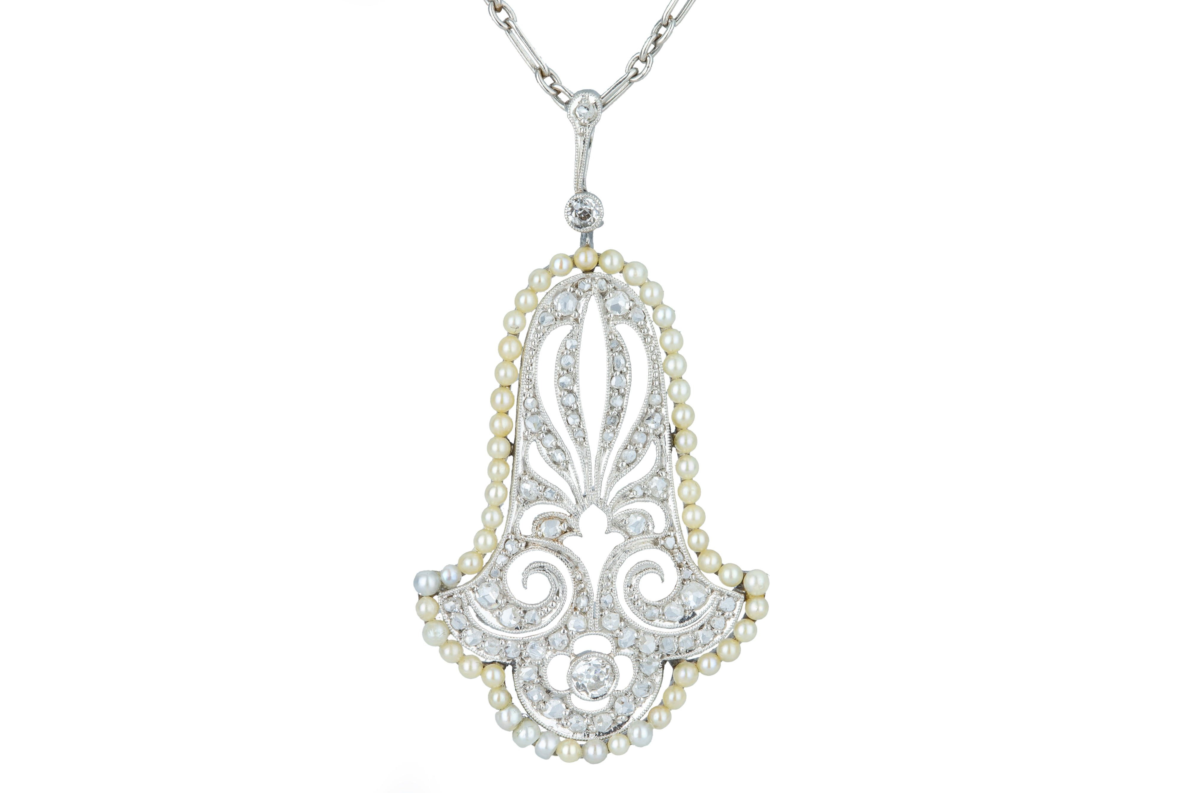 A delicate Art Deco diamond and seed pearl pendant.