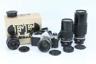 A Nikon FE SLR Camera Outfit,