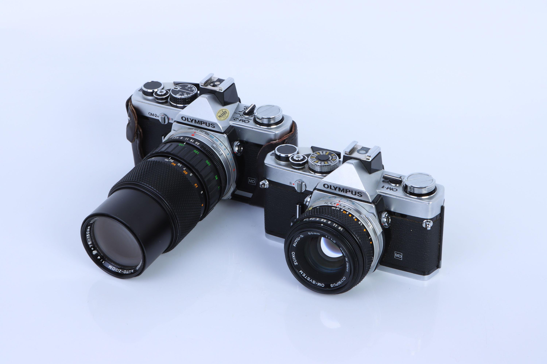 Two Olympus OM SLR Cameras,