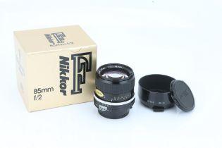 A Nikon Ai Nikkor f/2 85mm Lens,