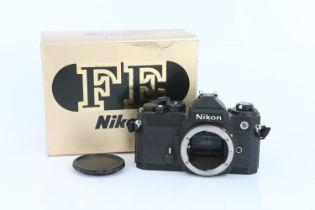 A Nikon FE SLR Body,