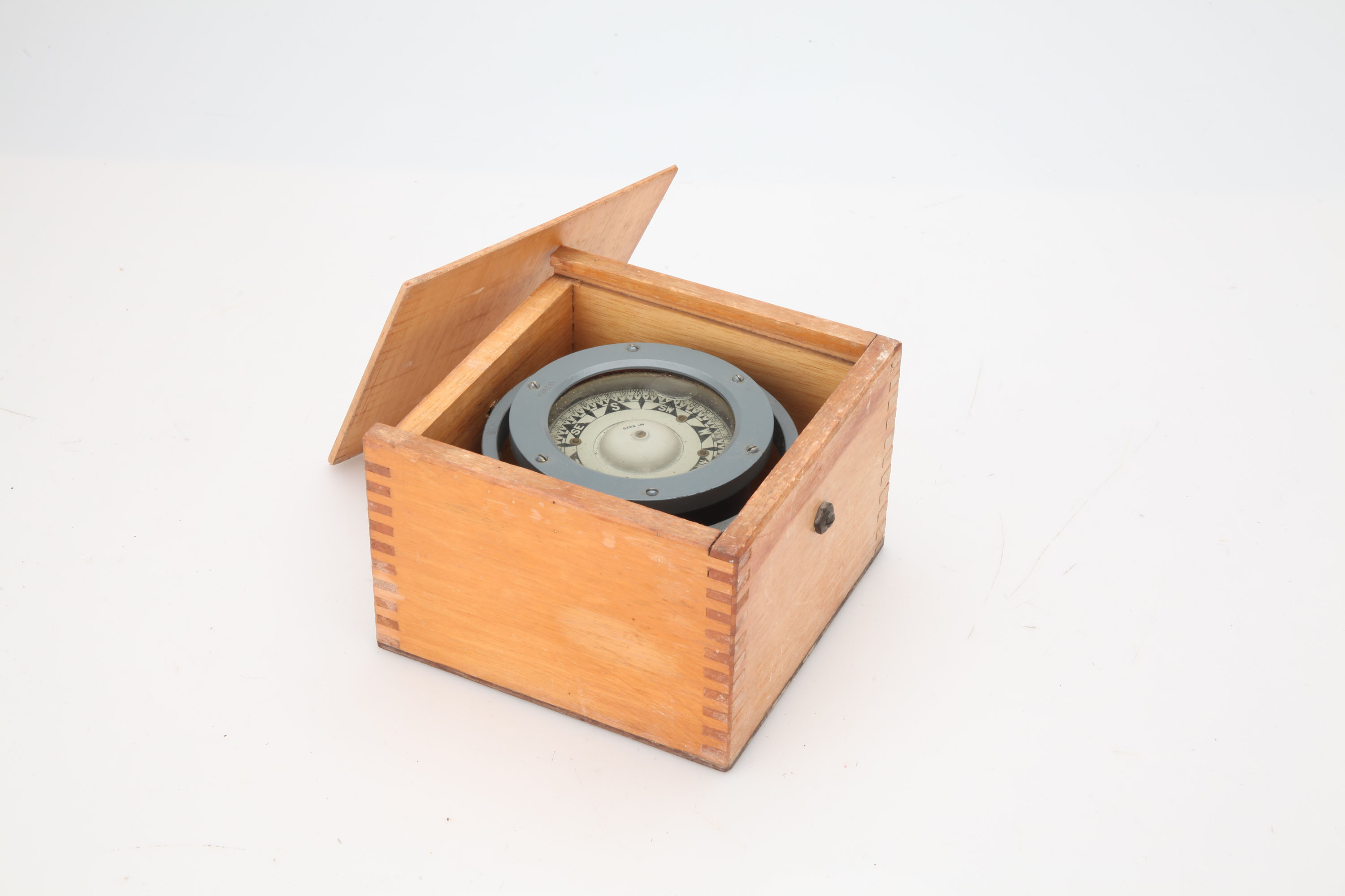A Cased Floating Card Compass,