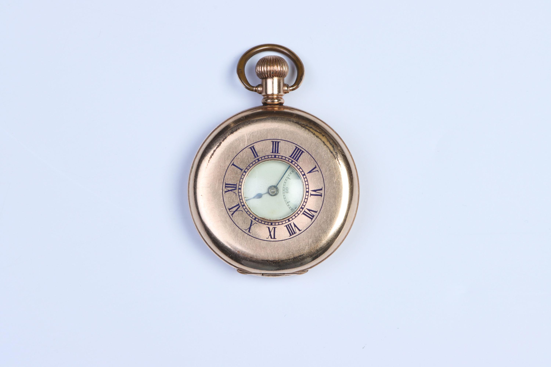 A Half-Hunter Pocket Watch,