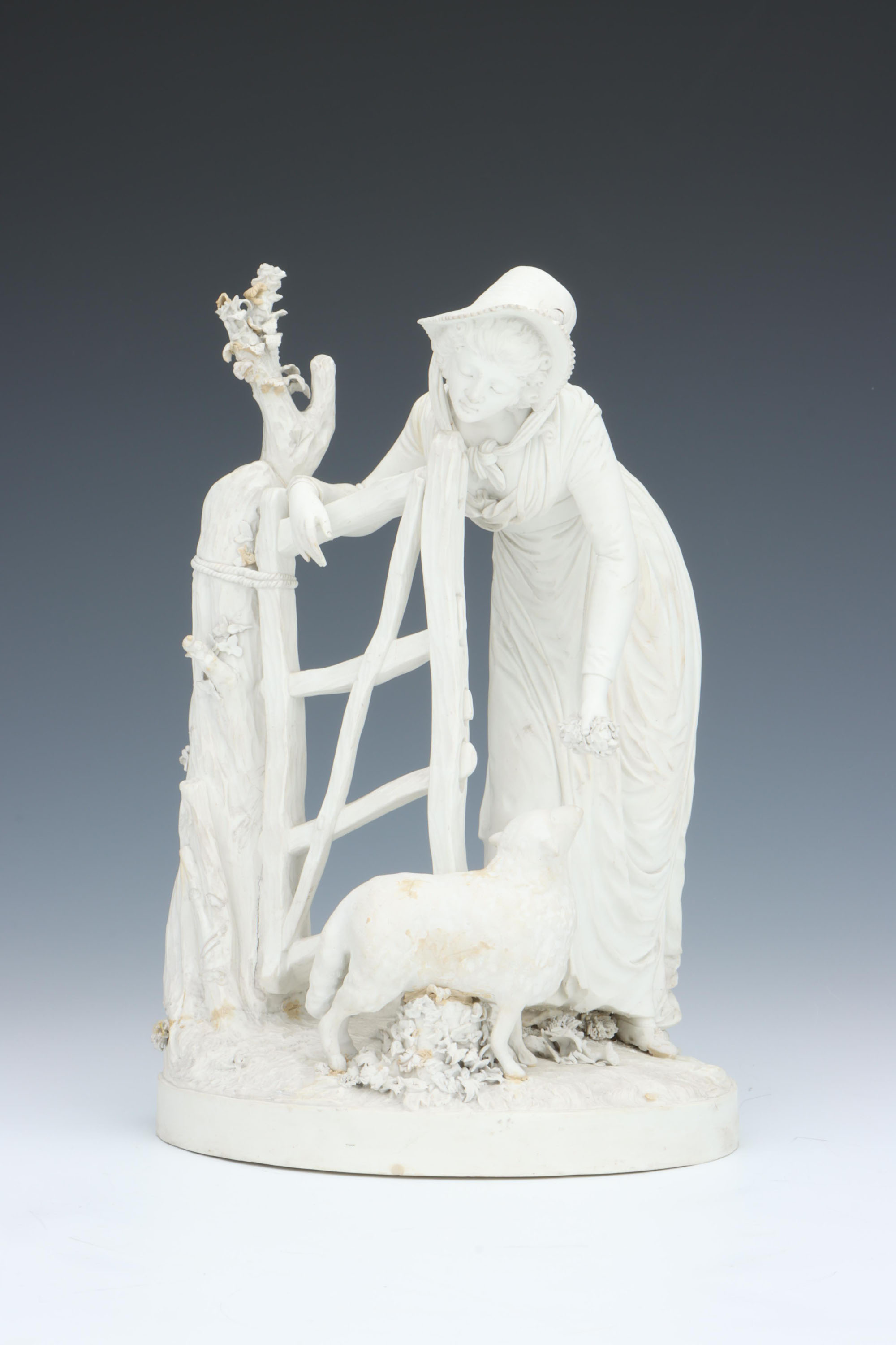 A Rare Derby Biscuit Figure of a Shepherdess,