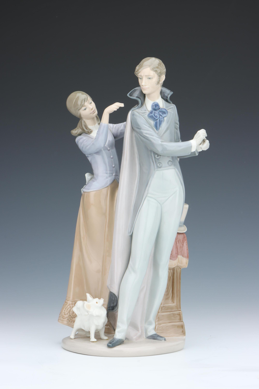 A Lladro Figure of a Gentleman & Lady,