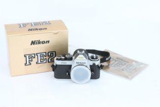 A Nikon FE2 SLR Body,
