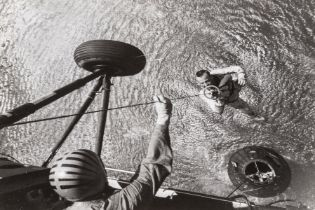 Alan Shepard, the first American in space, winched aboard a helicopter after splashdown, 5 May …