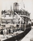 Windrush.- 16 press photographs documenting the arrival of the Windrush generation of West Indian …