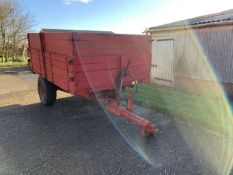 Tye single axle grain trailer with wooden sides and extensions