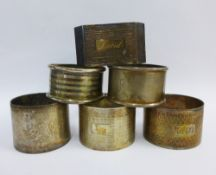 A collection of six various silver napkins, with a red leather napkin ring box (7)