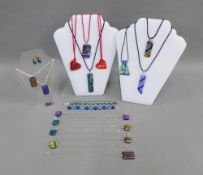 A collection of dicroic glass pendant necklaces, bracelets and earrings (21)