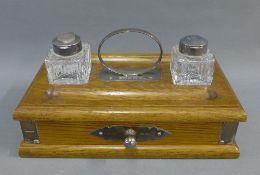 Oak and silver mounted desk inkstand, Schaeffer, Birmingham 1990, of rectangular form with a pair of