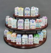 Set of twenty three Brooks & Bentley condiment and spice jars, modelled as house and contained on