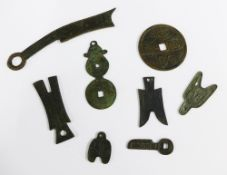 A collection of replica Chinese bronze coinage (8)
