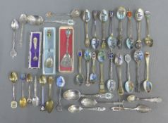 A collection of silver and white metal souvenir teaspoons (36)