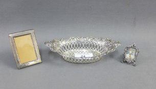 Silver bonbon basket, Birmingham 1901 and two small silver photograph frames, smallest 3cm, (3)