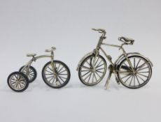 Miniature silver bicycle together with a silver tricycle, both stamped 925, tallest 6cm (2)