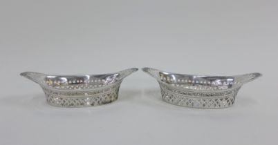 A pair of Victorian silver pierced oval basket bonbon dishes, Sheffield 1894, 16cm long (2)