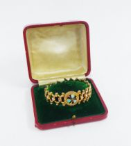 Early 20th century 9ct gold expanding bracelet, centred with a clover motif of three opals with a