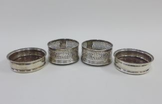 A pair of Scottish silver wine slide coasters, Edinburgh 1991, and another pair with hallmarks for