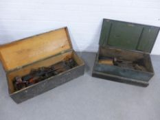 Two pine storage boxes / trunks containing a quantity of vintage tools to include wood working