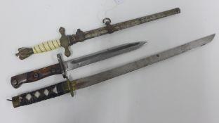 Replica Nazi dagger and scabbard, bayonet and a small dagger, (3)