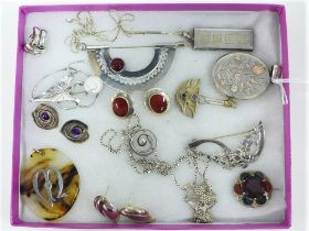 A collection of silver and white metal jewellery to include brooches, necklaces and earrings, etc (a