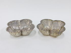 George V silver baskets, quatrefoil shaped with pierced sides, by William Hutton & Sons,