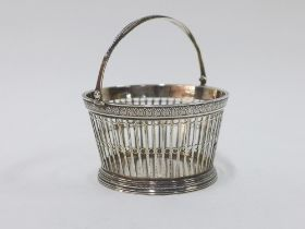 Dutch white metal basket by Diemont with a swing handle and pierced sides, stamped to the base, 10cm