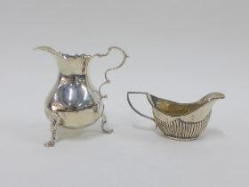 Georgian silver cream jug, rubbed, London hallmarks, 9cm, and a Georgian style silver gilt miniature